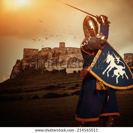 Medieval knight against Spis castle, Slovakia - stock photo