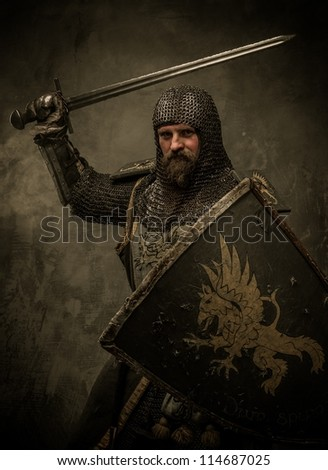 Medieval knight in attack position - stock photo