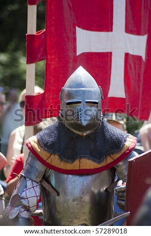 Medieval knight in full armor ready to fight - stock photo