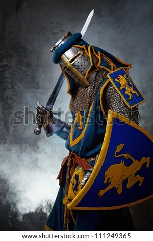Medieval knight on abstract background - stock photo