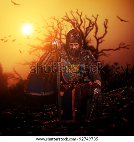 Medieval knight on his knee. - stock photo