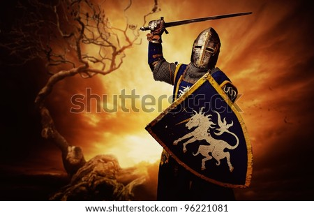 Medieval knight over stormy sky. - stock photo