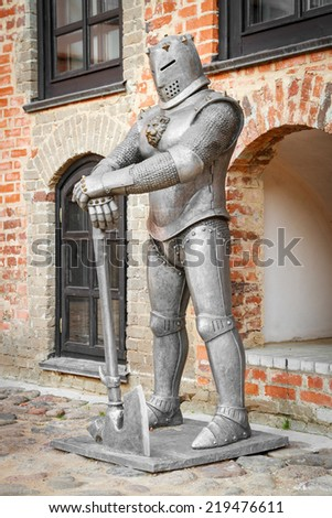 medieval knight with axe near castle  - stock photo
