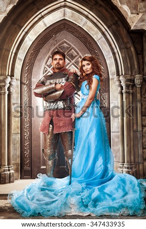Medieval knight with his beloved lady - stock photo