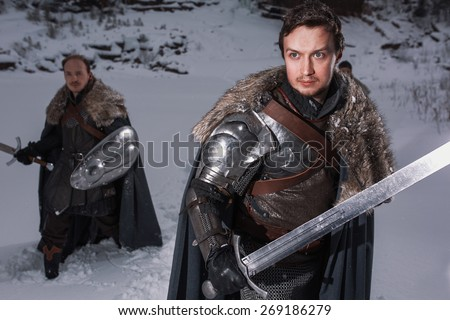 Medieval knights Prepare for battle as style Game of Thrones in Winter Rock Landscapes - stock photo