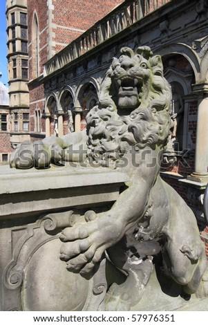 medieval lion sculpture guarding Frederiksborg Castle near Copenhagen, Denmark - stock photo