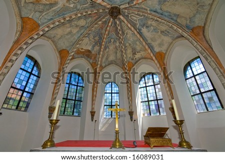 medieval little church interior with windows and fresco's at the ceiling - stock photo