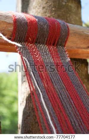 Medieval loom - exhibition of weaving old techniques - stock photo