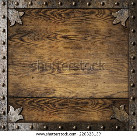 medieval metal frame over old wooden background - stock photo