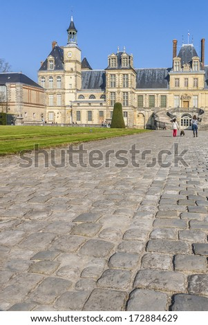 Medieval royal hunting castle Fontainbleau near Paris in France. - stock photo