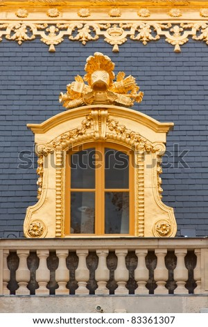Medieval Royal Palace window in the golden frame. - stock photo