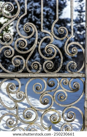 Medieval scrollwork gate. Handforged cast iron bent into ornamental spirals./Beautiful Cast Iron Gate Background - stock photo