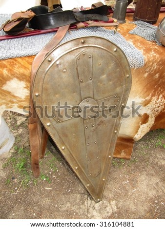 Medieval shield on warcamp. - stock photo