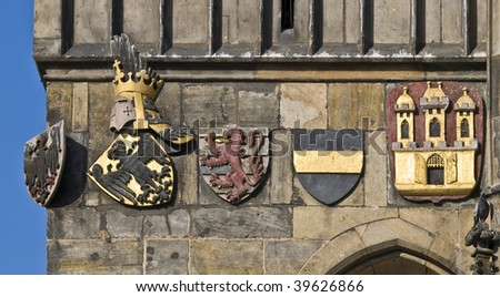 Medieval shields located on the facade of a castle - stock photo