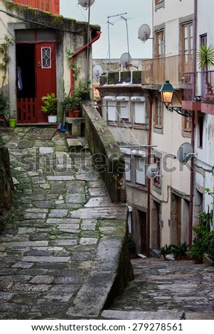 Medieval sloping alley in Ribeira, Old Town of Porto in Portugal, historic city centre.