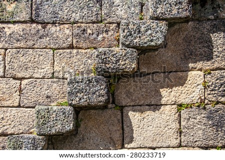 Medieval stairs in fortress wall, texture, background of stone wall