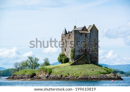 Medieval Stalker Castle on small island in loch linnhe argyll in the scottish highlands - stock photo
