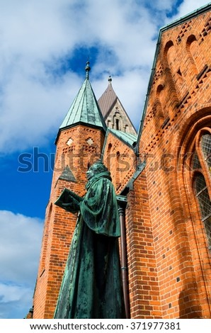 Medieval statue in front of a cathedral in the Danish city Ribe - stock photo