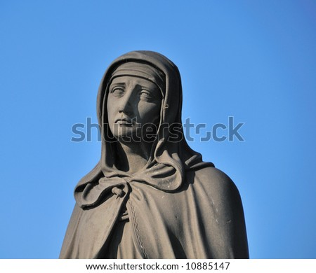 Medieval Statue of Mary on Prague's Charles Bridge - stock photo