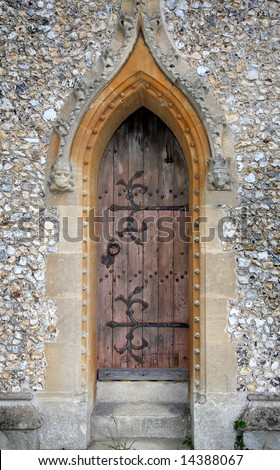 Medieval Stone Arch and wooden door to an English Village Church