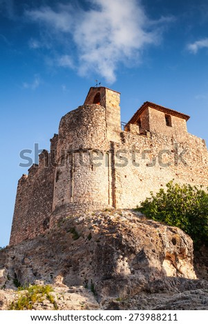 Medieval stone castle on the rock in Spain. Main landmark of Calafell town, vertical photo - stock photo