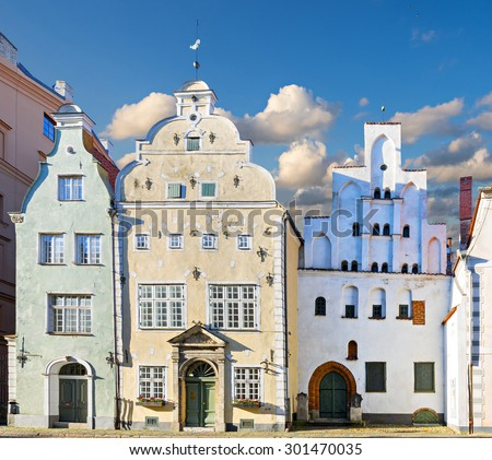 Medieval street in the old Riga city, Latvia. The image depicts the oldest buildings located in historical center of Riga  - stock photo