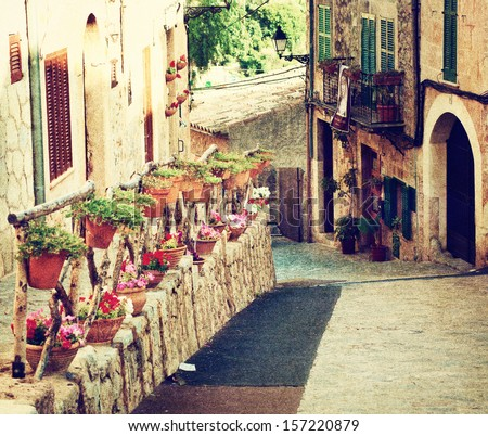 Medieval street of Valldemossa old town in vintage style, Mallorca, Balearic island, Spain - stock photo