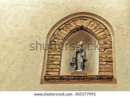 medieval streets and ancient memories - Catholic icon of Blessed Virgin Mary with Child Jesus a medieval village in Italy, between historical buildings and private homes - stock photo