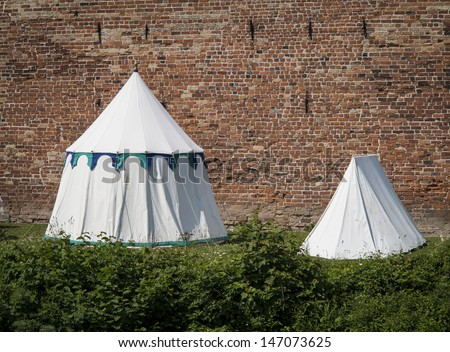 Medieval tents in front of Nyborg Castle, Denmark  during the Danehof Market 2013. - stock photo