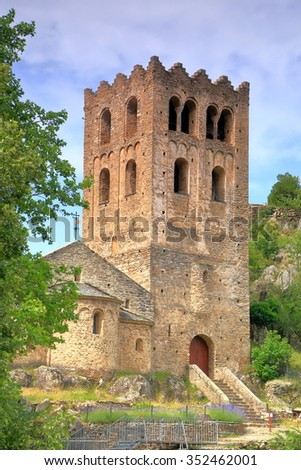 Medieval tower above the old church of the monastery of St Martin du Canigou, Pyrenees-Orientales department, France