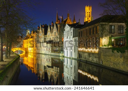Medieval tower Belfort and the Green canal, Groenerei, at night in Bruges, Belgium - stock photo