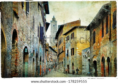 medieval Tuscany. Streets of San Gimignano. Artistic picture - stock photo