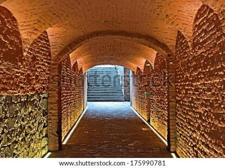 Medieval underground passage in historical center of Mons, Belgium - stock photo