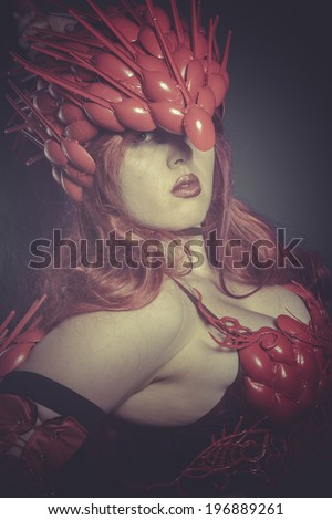 Medieval Valkyrie war woman dressed in red armor and helmet dragon scales