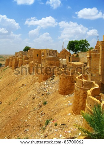 "Medieval walls of Jaisalmer, the magnificent ""Golden City"" in the heart of Rajasthan (India), surrounded by the desert of Thar - stock photo"