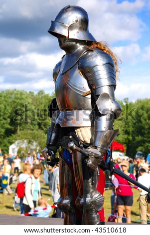 Medieval warrior in body armour - stock photo