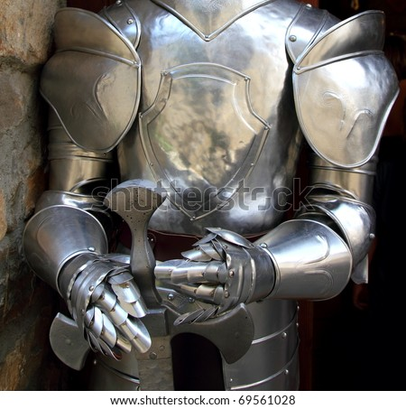 Medieval warrior soldier metal protective wear swordman - stock photo