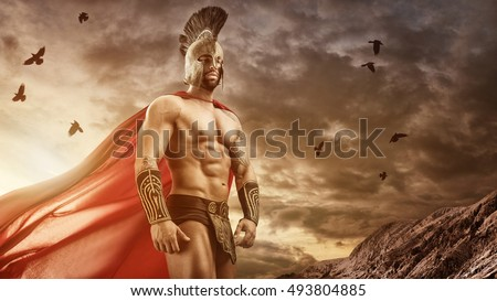 Medieval warrior standing in front of the gloomy clouds