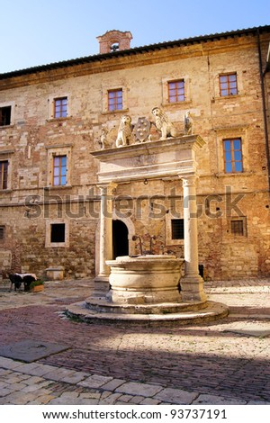Medieval well in a square in the Tuscan hill town of Montepulciano