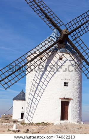 Medieval windmills dating from the 16th century on a hill overlooking the town of Consuegra in Toledo province, Castilla La Mancha, central Spain.