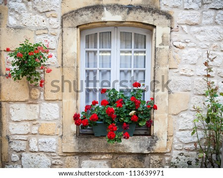 Medieval window in Monpazier, France - stock photo