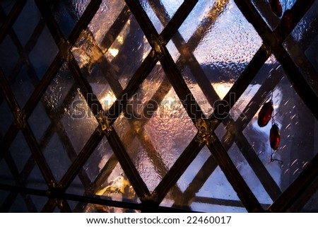 Medieval window in winter evening, Tallinn, Estonia, Christmas time