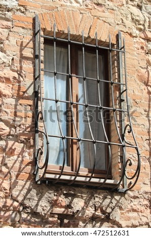 Medieval window with cantilevered grate