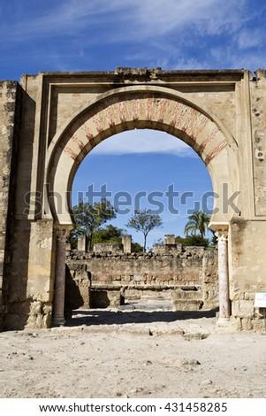 MEDINA AZAHARA, SPAIN - September  11, 2015: Detail of the main arch entrance of the Great Portico at Medina Azahara medieval palace-city near Cordoba, on September  11, 2015 in Medina Azahara, Spain - stock photo