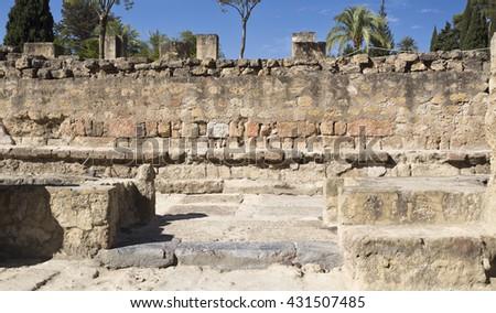 MEDINA AZAHARA, SPAIN - September  11, 2015: Ruins of the ramped street connecting the Great Portico to the Upper Terrace of Medina Azahara near Cordoba on September  11, 2015 in Medina Azahara, Spain - stock photo