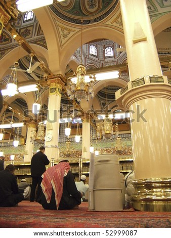 MEDINA-JAN 8 : Muslims read Quran and pray inside of Masjid Nabawi Jan 8, 2008 in Medina, Saudi Arabia. Nabawi Mosque is the second holiest mosque in Islam and here is Prophet Muhammad is laid to rest