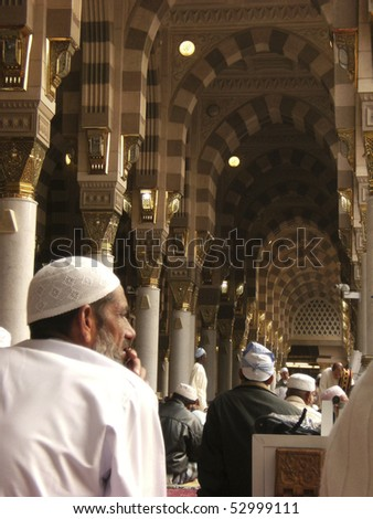 MEDINA-JAN 10:Muslims read Quran and pray inside of Masjid Nabawi Jan 10, 2008 in Medina, Saudi Arabia. Nabawi Mosque is the second holiest mosque in Islam and here is Prophet Muhammad is laid to rest
