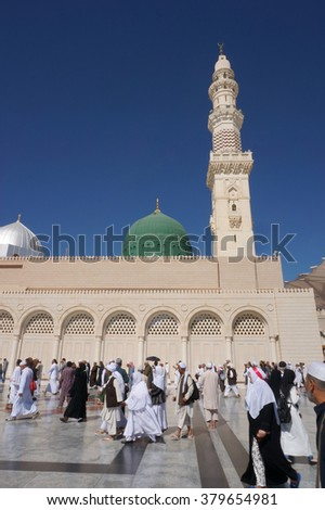 MEDINA, KINGDOM OF SAUDI ARABIA (KSA) - February 07: Muslims marching in front of the mosque of the Prophet Muhammad on February 07, 2016 in Medina, KSA. Prophet's tomb is under the green dome.
