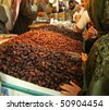 MEDINA, KINGDOM OF SAUDI ARABIA (KSA) - JANUARY 10 : Arabs sell fresh dates at dates bazaar January 10, 2008 in Medina, KSA. Dates are usually consumed by muslims around the world to break their fast. - stock photo
