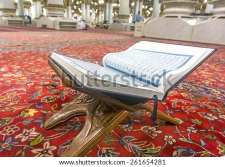 MEDINA-MAR 08 : A Quran inside of Masjid Nabawi March 08, 2015 in Medina, Saudi Arabia. Nabawi Mosque is the second holiest mosque in Islam - stock photo
